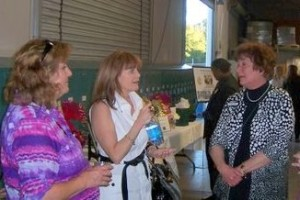 RC Ferris, Susan Hurl, and Sandy Henry enjoy the opportunity to network.